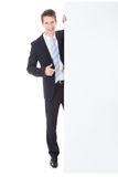 Businessman holding placard Royalty Free Stock Photography