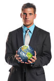 Businessman holding planet earth. Isolated on a white background royalty free stock photography