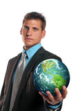 Businessman holding planet earth. Isolated on a white background royalty free stock images