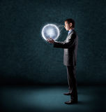 Businessman holding planet earth royalty free stock images