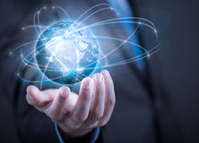 Businessman holding planet Earth in palm Stock Image