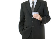 Businessman holding poker cards Royalty Free Stock Image