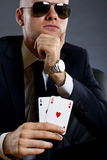 Businessman holding a poker hand Stock Image