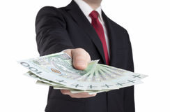 Businessman holding polish money. Stock Photography