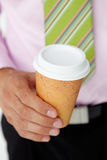 Businessman holding portable cup of coffee Stock Photography