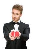 Businessman holding present box royalty free stock photography