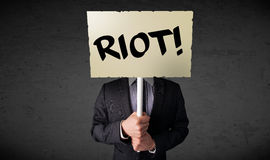 Businessman holding a protest sign Royalty Free Stock Photography