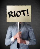 Businessman holding a protest sign Royalty Free Stock Image