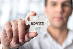 Businessman Holding Puzzle Piece with Advice Text Royalty Free Stock Photo