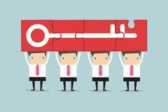 Businessman holding puzzle success key, Teamwork Concept. Stock Images