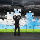 Businessman holding puzzles to assembly turning bad situation Stock Images