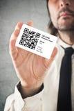 Businessman holding QR code business card Stock Photos