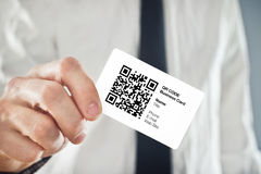 Businessman holding QR code business card Royalty Free Stock Images