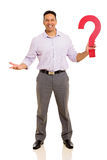 Businessman holding question mark Stock Photos