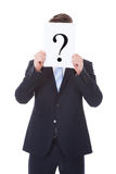 Businessman Holding Question Mark Sign In Front Of Face Royalty Free Stock Photo