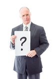 Businessman holding question mark sign Royalty Free Stock Image