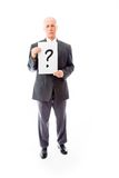 Businessman holding question mark sign Stock Photography