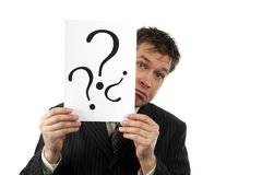 Businessman is holding question marks Stock Photography