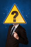 Businessman holding question sign Stock Photography