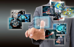 Businessman holding Reaching images streaming in hands .Financia Stock Images