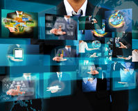Businessman holding Reaching images streaming in hands Stock Photos