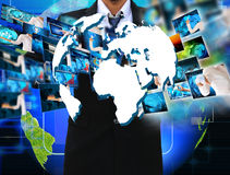 Businessman holding Reaching images streaming in hands Stock Photography