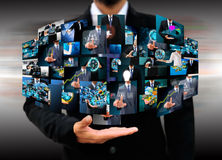 Businessman holding Reaching images streaming in hands Royalty Free Stock Photo