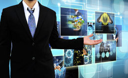 Businessman holding Reaching images streaming in hands Royalty Free Stock Images