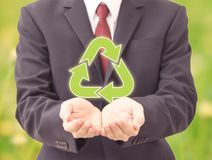 Businessman holding recycle icons Stock Image