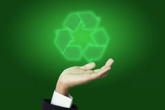 Businessman holding recycle sign Stock Image