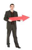 Businessman holding red arrow Stock Image