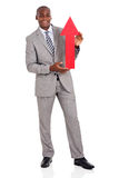 Businessman holding red arrow Stock Photo