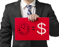 Businessman holding a red board with drawing time is money concept. Businessman use one hand to hold a red board with drawing time is money concept, close up in Royalty Free Stock Photos