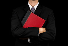 Businessman holding red book Stock Images