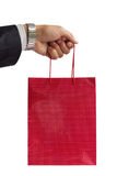 Businessman holding red gift bag Royalty Free Stock Photo