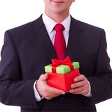 Businessman holding  red gift box Royalty Free Stock Image