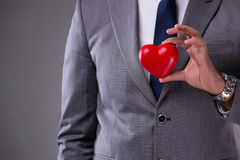 The businessman holding red heart in love concept royalty free stock photography