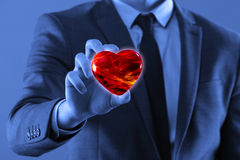 The businessman holding red heart in medical concept. Businessman holding red heart in medical concept stock photography