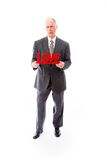 Businessman holding a red Love text in frustration Stock Photos