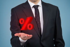 Businessman holding red percentage Royalty Free Stock Image