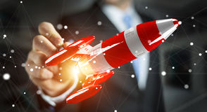 Businessman holding red rocket in his hand 3D rendering Royalty Free Stock Images