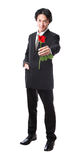 Businessman holding a red rose,attractive 40 years old asion man Royalty Free Stock Image