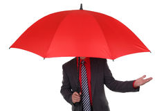 Businessman holding red umbrella. Concept for insurance agent, finance protection or problems Stock Photos