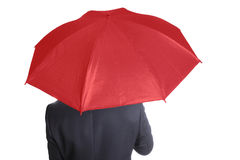 Businessman holding red umbrella Royalty Free Stock Photos