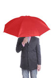 Businessman holding red umbrella Royalty Free Stock Images