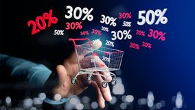 Businessman holding a Red and white Trolley and sales discount -. View of a Businessman holding a Red and white Trolley and sales discount - 3d render Royalty Free Stock Photos