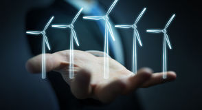 Businessman holding renewable energy sketch Royalty Free Stock Photo