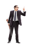 Businessman holding a rifle and gesturing with finger Stock Image