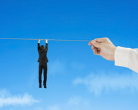 Businessman holding rope in blue sky Royalty Free Stock Photography