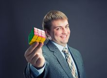 Businessman holding rubik cube in his hands Royalty Free Stock Photos